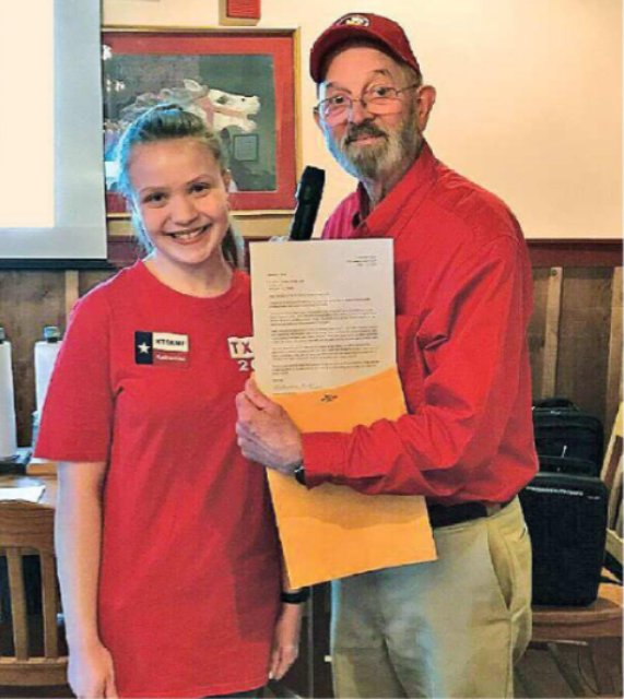 Katherine Forson, KT5KMF, was congratulated by MARC President Bill Vining, N5YZ, after she presented her award-winning project at a club meeting.